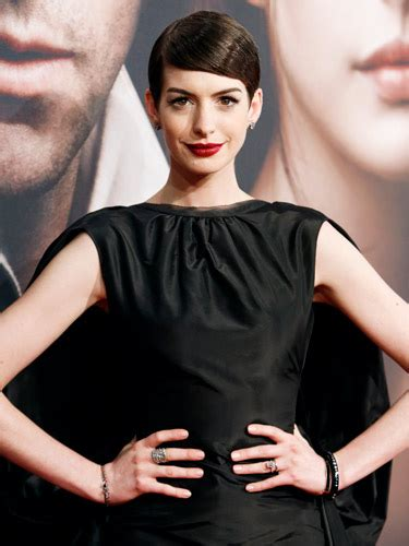 Anne Hathaway steals the spotlight in pearl dress at Les